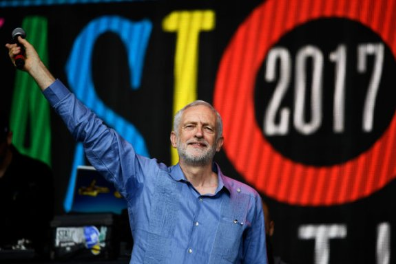 Britain's opposition Labour Party leader Jeremy Corbyn acknowledges the crowd at Worthy Farm in Somerset during the Glastonbury Festival